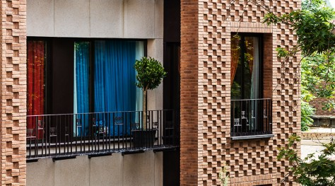 Haghighi Residential Building / Boozhgan Studio + AAD Studio